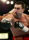 Klitschko Retains Titles With Final Round Knockout of Chambers