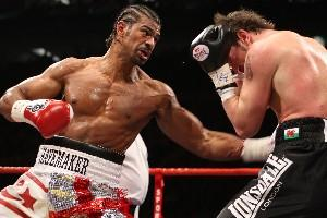 Haye unleashes a left hook to the body of Maccarinelli