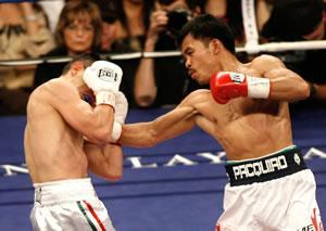 Pacquiao takes Diaz apart: HoganPhotos.com