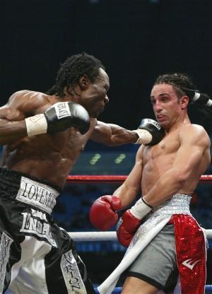 Ndou lands on Paul Malignaggi: HoganPhotos.com