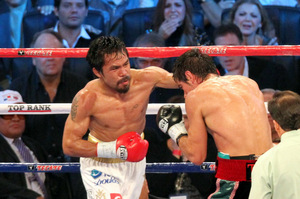 Manny Pacquiao pummeled a brave but outgunned Antonio Margarito. Photo by Tri Nguyen.