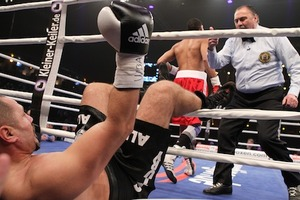 Ali Ismailov falls through the ropes