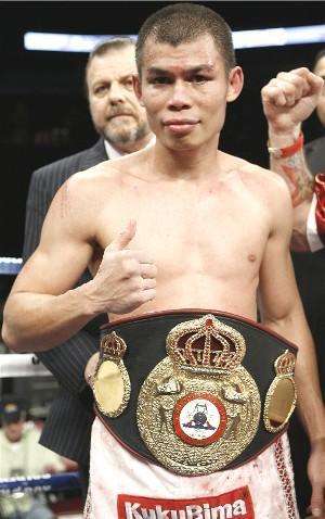 John retains his WBA title with a draw: HoganPhotos.com