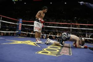Pacquiao sends Hatton crashing to the canvas