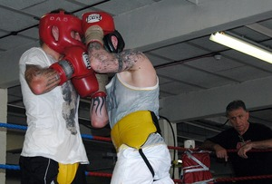 Burns sparring with Mitchell