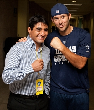Morales with Dallas Cowboys' Tony Romo