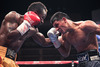 Mares Squeaks Past Agbeko; Fight Mired in Controversy