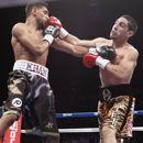 Garcia stops favored Khan in 4th round (The Associ
