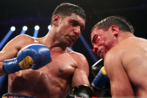 Khan bashes up Molina (pics Tom Casino)