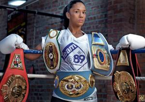 Serrano possing with her belts