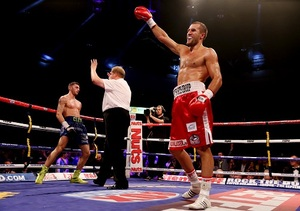 Kovalev raises his hand in victory
