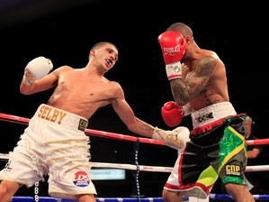 Selby aims a left hook at Munroe