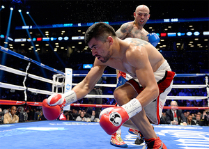 Collazo look on as Ortiz Falls.