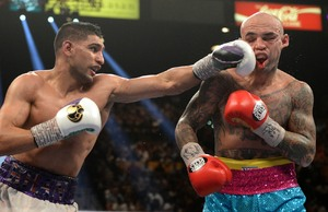 Khan Pummels Collazo, Earns Decision