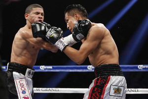 Vargas Out-Slugs Lopez, Scores TKO