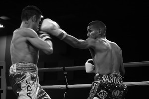 Santiago Makes Statement By Defeating Garcia
