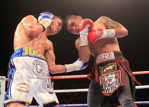 Warrington Defends Titles Against Brunker