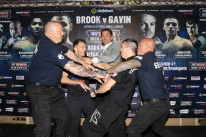 Cardle And Evans Clash At Press Conference