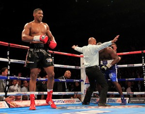 Joshua Takes Out Johnson Inside 2 Rounds
