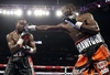 Crawford Defends Titles Against Molina Jr