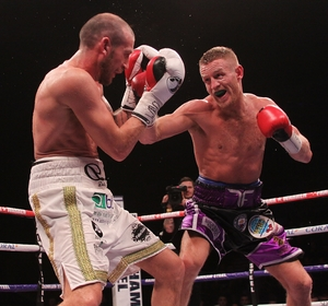 Terry Flanagan holds position with stoppage of Orlando Cruz.