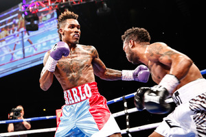 Charlo defeating Trout.