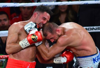 Gritty Ward stops Kovalev in rematch