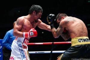 Pacquiao KO's Matthysse, Captures WBA Title