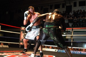 Conquest Defends title against McKenzie