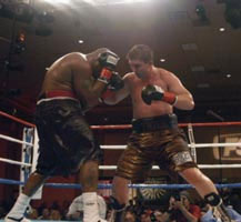 Jirov in action against Michael Moorer (pic by Harry Rosenbluth)