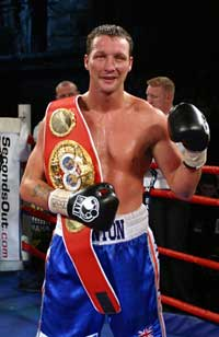 A proud Clinton Woods shows off the IBF belt after defeating Rico Hoye (Mr Will)